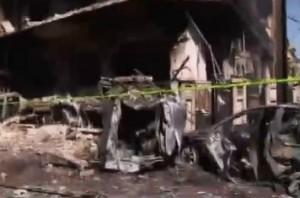 שרידי מכונית התופת בזירת אחד הפיגועים, מוקדם יותר היום