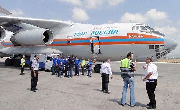 המטוס הרוסי לפני יציאתו מלטקיה  (צילום: SANA)