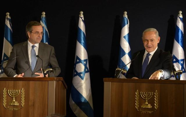 """""""האיראני מחפש הסכם חלקי שיוביל להקלת הסנקציות"""". נתניהו וראש ממשלת יוון סאמאראס ((צילום: עמוס בן גרשום/לע""""מ)"""
