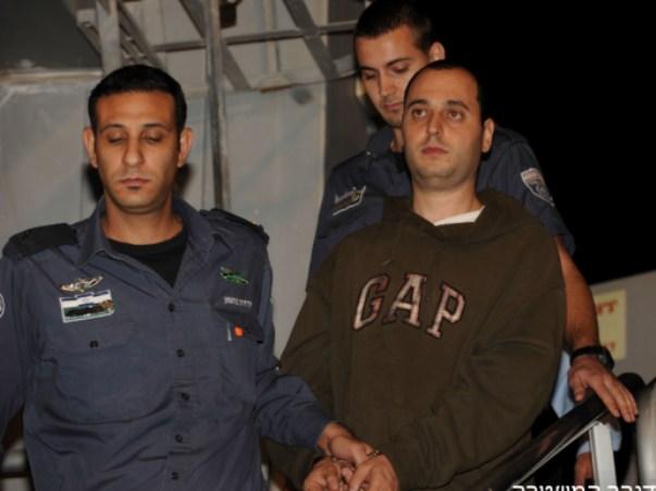 בן איבגי מוסגר לישראל (צילום: דובר המשטרה)
