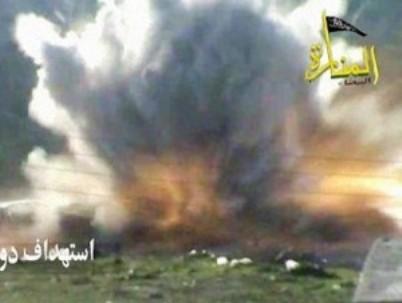 הפעלת מטען צד (מתוך סרטון של מחבלי ג'בהת אל-נוצרה)