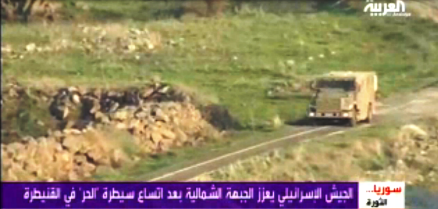 רכב ממוגן ירי נע לאורך הגבול הסורי באזור הפיגוע (צילום מסך - רשת אל-ערבייה)