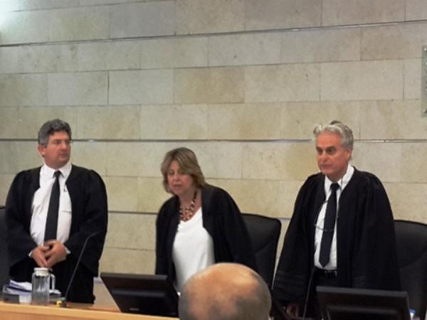 """""""דיון בעניין עקרוני"""" נשיא בית הדין הארצי - יגאל פליטמן ראשון מימין (צילום: אליק מאור)"""