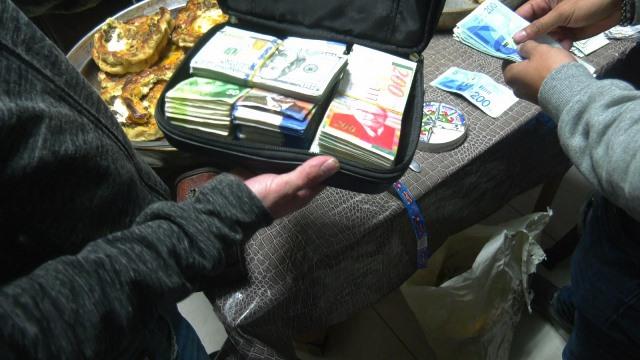 הכסף שנתפס (צילום: משטרת ישראל)