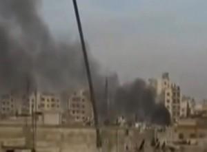 עשן מיתמר  בעיר חומס מעל שכונת באבא עמרו