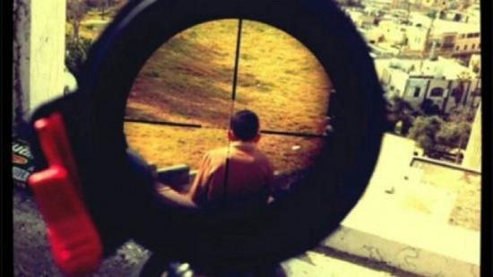 סערה ברשת: חייל פירסם תמונות של ילד פלסטיני בצלב הכוונת