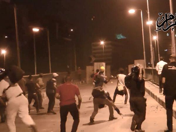 הקרב על הגשר בקהיר בין תומכי מורסי למתנגדיו (מקור: אל אהראם)