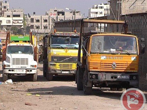 משאיות הזבל המושבתות (צילום: סוכנות מען)