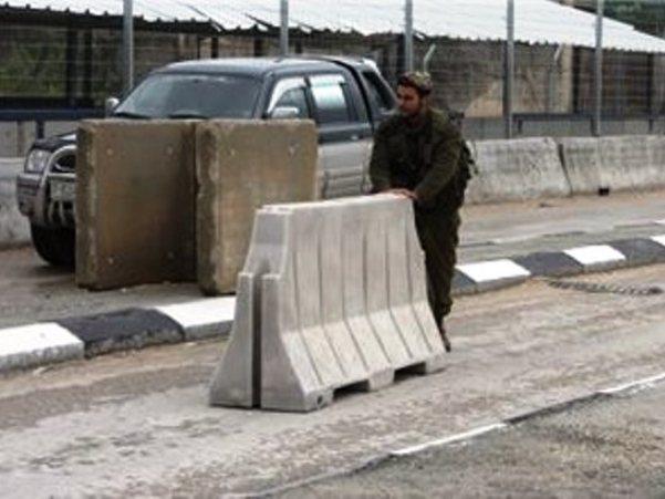 חייל במעבר ביתוניא (צילום: מען)
