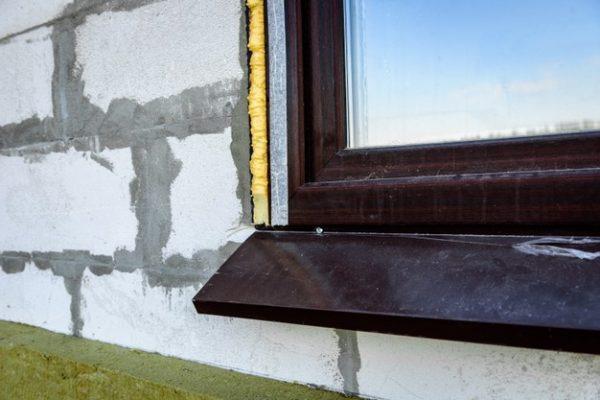 construction-foam-sealed-gap-plastic-window-block-wall_176402-7225