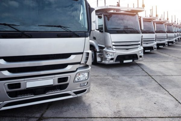 group-trucks-parked-row_342744-533