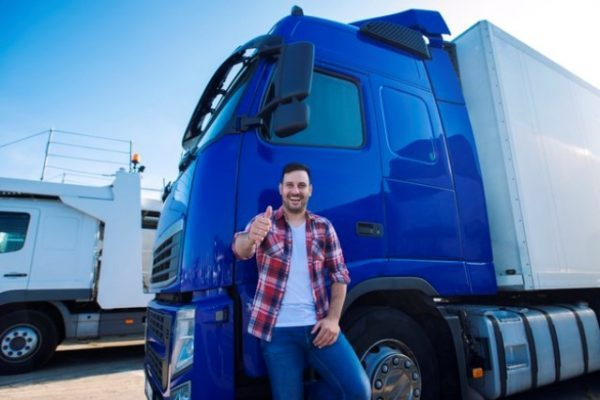 professional-truck-driver-front-long-transportation-vehicle-holding-thumbs-up-ready-new-ride_342744-1343