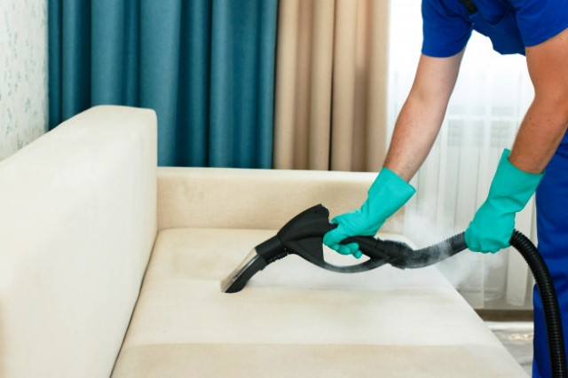 employee-cleaning-company-provides-chemical-steam-cleaning-service-sofa-steam-cleaner_156874-73