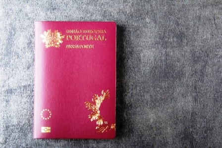Portuguese passport isolated on gray background top view