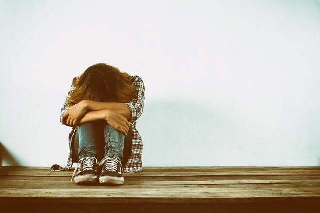 Sad woman hug her knee,nobody