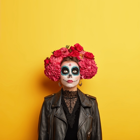 indoor-shot-female-model-has-artistic-designed-face-wears-professional-horror-makeup-halloween-holiday-dressed-special-costume-focused-upwards-isolated-yellow-wall-copy-space